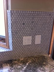 Kitchen backsplash in round marble mosaic