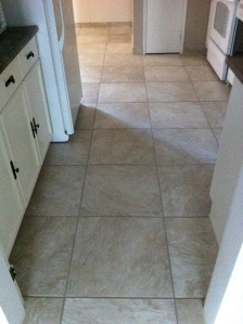 """Tile floor in Ceramic tiles 20"""" x 20"""" in whole main floor"""