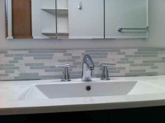 moulded sink with mosaic tile backsplash