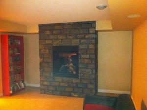 fireplace surrounding in a basement familyroom